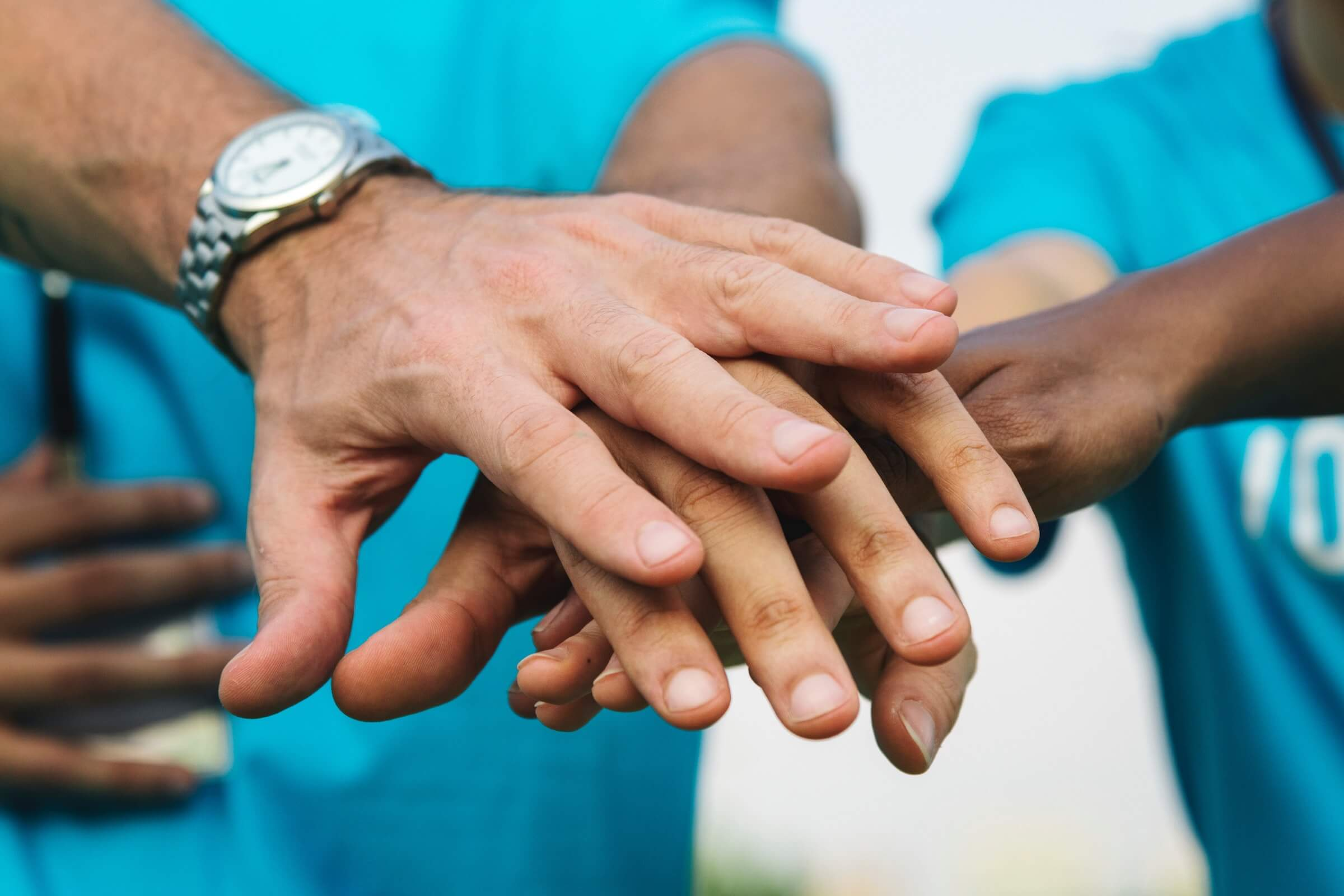 Hands on top of each other - UNICEF Testimonial of London Creative Designs