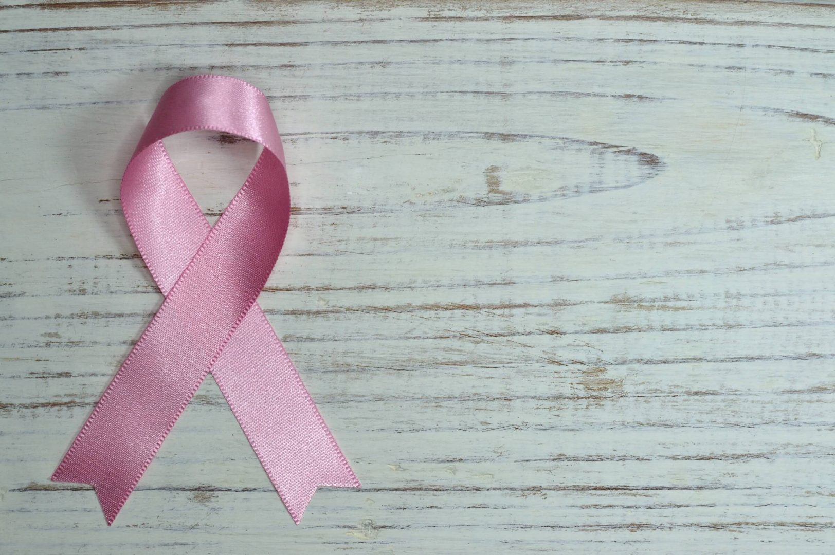 Pink ribbon - pro-bono work done for charities by London Creative Designs